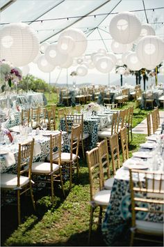 white lanterns and gold chairs