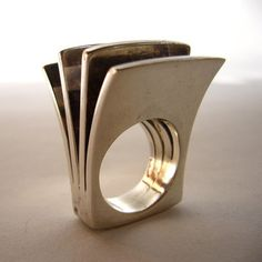 This '70s Finnish statement ring is the reason why shopping for vintage jewelry is so much fun. With its curved sleek forms and fanned-out shape, the sterling silver piece is a perfect one-of-a-kind find.  Designed by Pekka Piekainen for Auran Kultaseppa of Finland.  From 20th Obsession on Fab.com for 286, but it's sold out.