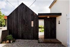 Before and After: A Charred Wood Cottage, on a $45K Budget by Michelle Slatalla. NeM Architects. Brittany; Gardenista. Connected by a covered walkway to the existing house, the new cottage is a mini replica of the old.