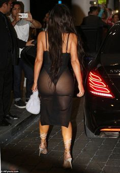 Peek-a-boo: She had no problem putting her famous assets on display...