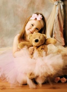 little girl and her teddy bear