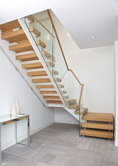 A wonderfully simple staircase feature a dual run steel carcass with light solid oak stair treads. Installation and size was key on this project, the. Oak Stairs, Glass Stairs, Steel Stairs, Glass Railing, House Stairs, Staircase Storage, Interior Staircase, Banisters, Stair Treads