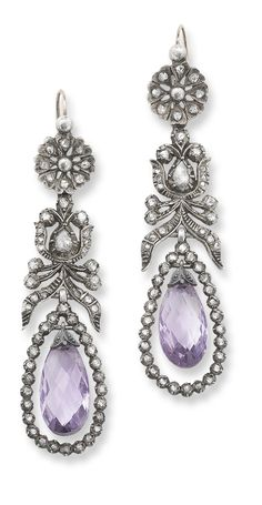 A pair of amethyst and diamond ear pendants, 1800. Of pendeloque form, each designed as a rose-cut diamond flower cluster surmount suspending a similarly cut diamond foliate drop to a later briolette-cut amethyst suspended within a rose-cut diamond frame, length 7.3 cm, wire clip fittings, composite. #Georgian #antique #earrings