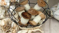 Delicate old lace wrapped on vintage wooden spools