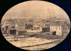 """Early photo Old West mining town Denver, Colorado in 1860. On the right is the, """"Rocky Mountain News"""" paper building. A newspaper that lasted up until recently."""