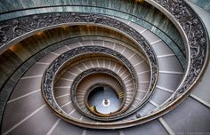 Inside the Vatican Museum in Rome, you'll find the Bramante Staircase. Designed as a double helix by Giuseppe Momo in 1932, it has become one of the most recognizable and photographed spiral staircases in the world.  If you're interested in my work, feel free to drop me a line on Instagram or my website EliaLocardi.com.
