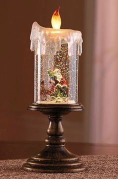 Lighted Santa Candle Snow Globe, Flameless LED Candle, http://www.amazon.com/dp/B008YFV7HS/ref=cm_sw_r_pi_awd_HchBsb0PN970G