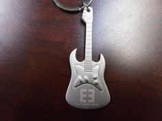 Engraved guitar keychain with logo