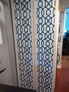 Full length cabinets decorated with NuWallpaper