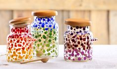 Oh, what a difference a dot makes! These cute little canisters—they come with a handy wooden scoop—started out as simple clear glass. We dabbed on some enamel paint to create the modern art motif you see here. Now they're perfect for bath salts, beads or coffee beans!