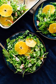 orange arugula salad on plates