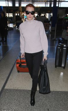 Pretty in pink! The Scream Queens actress was casual for her travels in a comfy pinky turt...