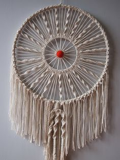 I think this item is used as a decorative piece but it reminds me of a dream catcher, a really complicated and beautiful one at that. I also like this piece because it exhibits several different knots, some of which are so simple that I already know how to make them, and uses them in a somewhat unconventional manner.