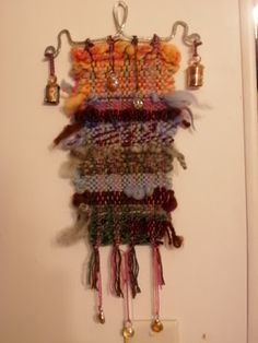 Woven wind chime. Reminds me of the 60's!