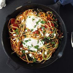 A hearty harissa vegetarian zucchini spaghetti skillet with poached eggs, kale, chickpeas and feta! Gluten-free.
