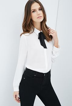 This cute collared blouse is from forever 21, it is semi-sheer and has buttoned cuffs. This comes with a tie it yourself bow on top for that Blair Waldorf look! #forever21
