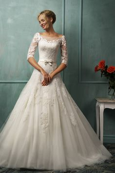 The stunning and elegant A-line bateau neck half sleeve white tulle floor-length chapel train wedding dress with duchess lace with the fully duchess lace bodice and the sexy open button back