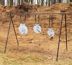 A -frame from a kids swing set to use for targets. Shooting Stand, Gun Shooting Range, Outdoor Shooting Range, Shooting Sports, Steel Targets, Metal Shooting Targets, Archery Targets, Steel Target Stands, Bow Target
