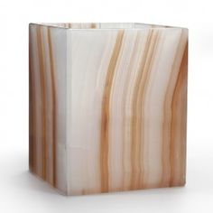 <p>This distinctive white onyx is swirled with rich shades of caramel. Naturally occurring fissures and quartz formations within the stone make each piece completely unique. The stone is polished to a beautifully glossy finish. Made In Mexico </p>