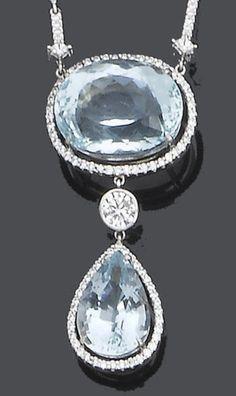 An aquamarine and diamond pendant necklace.