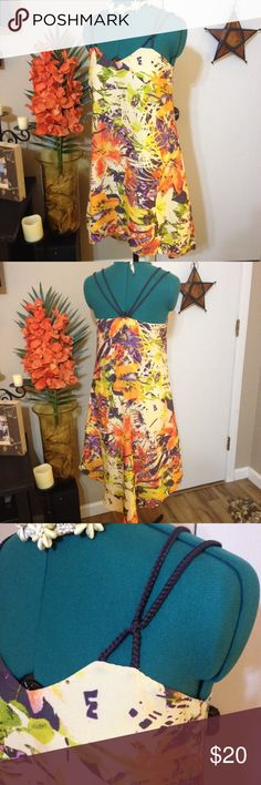 Jessica Simpson tropical floral dress Beautiful flowy Jessica Simpson floral dress. Tropical floral print in cream,orange,purple and green. High low hem and deep purple braided straps, lined with cream under skirt, very comfy. It had a matching floral print sash with it but i had it tied in my hair and it got lost. Has belt loops on sides, shown with belt in last picture, sorry not included. 100% polyester. I wore this dress once to a graduation party, everyone loved it!! Jessica Simpson…