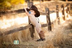 Cowboy boots and baby butts. First birthday pictures. Too cute for words. Cowboy and his paci!