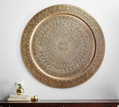 http://www.potterybarn.com/products/decorative-metal-disc-wall-art-brass/