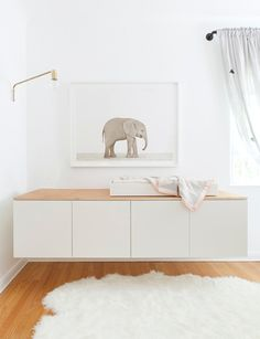 White changing table with large elephant print nursery