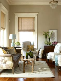 "This is the perfect ""neutral"" paint color for a home.  The room has an abundance of light, clean lines, yet just the right amount of accessories.  As a real estate professional, I love the look.  This would be a prime example of how to ""stage"" your home for a successful sale.  If you are lucky enough to live in it, then this is one Living Room that more than lives up to its name!"