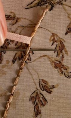 Embroidered by Di van Nieker, 2009  Wrapping the ribbon around the back stitches. Whipped back stitch.