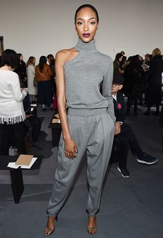 Look at how slinky and chic Jourdan Dunn's chunky asymmetrical knit is. Team with a pair of equally minimal cropped tailored trews, and you'll have a streamlined look that's got fancy Friday feels, too. Don't forget a strappy sandal on the heel front to keep things glam and happy hour-appropes