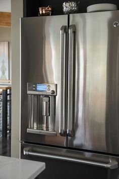 a sleek stainless steel refrigerator maximizes kitchen space with its counter depth design and