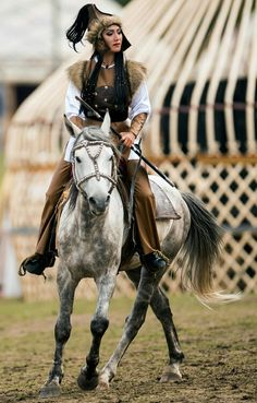 Magnificent woman warrior on horseback at World Nomad Games 2016