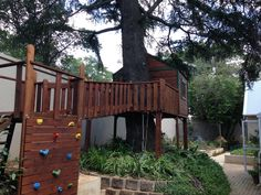Unique tree house designs to suit your budget built from high grade pine wood. Tree House Designs, Play Houses, Tree Houses, Unique Trees, This Is Us, Deck, Patio, Building, Outdoor Decor