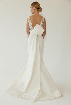 A ladylike wedding dress with a back bow by @cherrerany | Brides.com