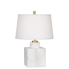 Monumental Modernism.Our Short Canaan Marble Table Lamp creates a futuristic, chic look. The rich Carrara or Marquina marble and modern shape make this lamp fab in pairs anchoring an entryway console. antiqued brass accents add a twinkly touch to an otherwise clean, modern design.Available in black Marquina marble with a white or black linen shade or in white Carrara marble with a white or grey linen shade.