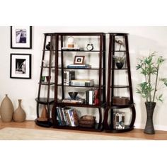 This elegant bookcase unit will add stylish storage to any room of your home, perfect for a living room, hallway, dining room, or home office. This unit is made up of a center bookcase with five spacious storage shelves, which will hold lots of books and decorative accent items.