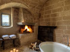 "Sextantio Le Grotte della Civita luxury boutique hotel ~ Matera, Italy ~ ""Restored from the abandoned and decaying ancient caves in the Basilicata village of Matera in Southern Italy"" Bathroom Fireplace, Stone Bathroom, Cozy Bathroom, Bathroom Interior, Beige Bathroom, Bathroom Modern, Master Bathroom, Romantic Bathrooms, Beautiful Bathrooms"