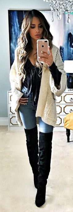 #winter #fashion /  White Cardigan / Black Top / Bleached Skinny Jeans / Black OTK Boots