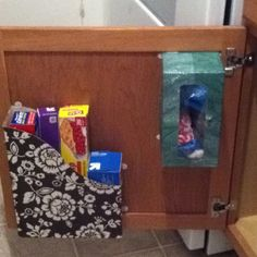 Two pins completed in one! An old ikea magazine box turned foil and wax paper holder plus an old tissue box to organize grocery store plastic bags.  Applied using command strips i already had.  A zero dollar win!