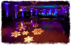 Snowflake lights to get in the holiday spirit! Dance floor snowflake gobo with blue uplights.