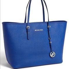 Michael Kors jet set travel tote in sapphire Beautiful saffiano leather. Zippered divider with an additional pocket. Side zippered pocket. Small dark mark on the left side. Michael Kors Bags Totes