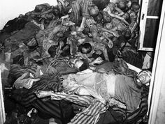 Bodies lie piled against the walls of a crematory room in a German concentration camp in Dachau, Germany. The bodies were found by U.S. Seventh Army troops who took the camp on May 14, 1945.