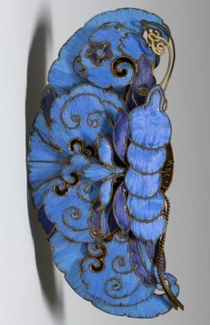 Hair Ornament, Qing Dynasty. This piece was likely once worn by the empress dowager, the effective ruler of China during the later years of the Qing Dynasty. It is an exquisite example of Chinese decoration and the symbolism used to express one's rank. The brilliant blue feathers of the kingfisher give it an eye-catching quality that anyone interested in being recognised would certainly embrace.