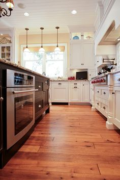 I like the contrasting cabinet colors; love the hardwood floors