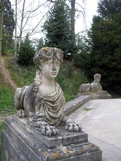 The Marie Antoinette's Belvedere is surrounded by numerous carved stone Sphinx each with different faces.