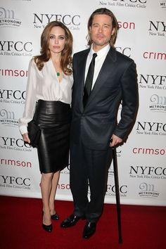 With Pitt at the New York Film Critics Circle Awards Gala, where he won the Best Actor Award. She wore a Salvatore Ferragamo white blouse and leather pencil skirt.