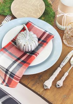 Every inch of this modern and fresh Thanksgiving tablescape is full of style. From the metallic jeweled pumpkins, plaid napkins, and twine wrapped silverware, it's rustic meets glamour with these fall decorations.