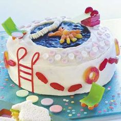 """Pool Party Cake -  This cleverly decorated cake with its """"pool"""" of cool blue gelatin will steal the show at any gathering!"""