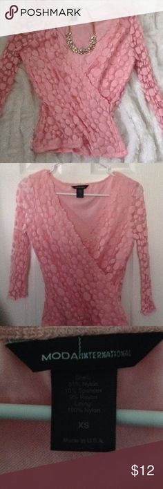 Pink Lace shirtSize XS Adorable baby pink shirt. So cute. Lace overlay the bodice. Arms with lace only. Size XS Moda International Tops Blouses